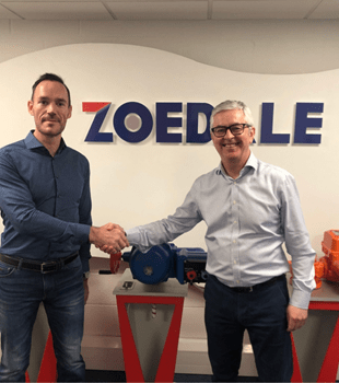 Tim and Richard shake hands over Zoedale acquisition